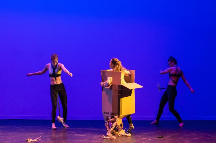 "photo of 3 dancers including one in box from ""Choking Hazard"" by Cecilia Pont"