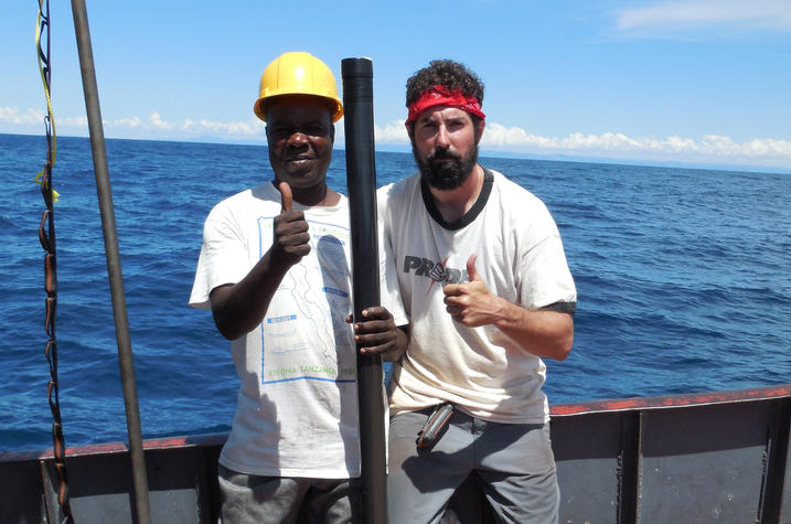 photo of Michael McGlue and M. Mupape recovering core sample