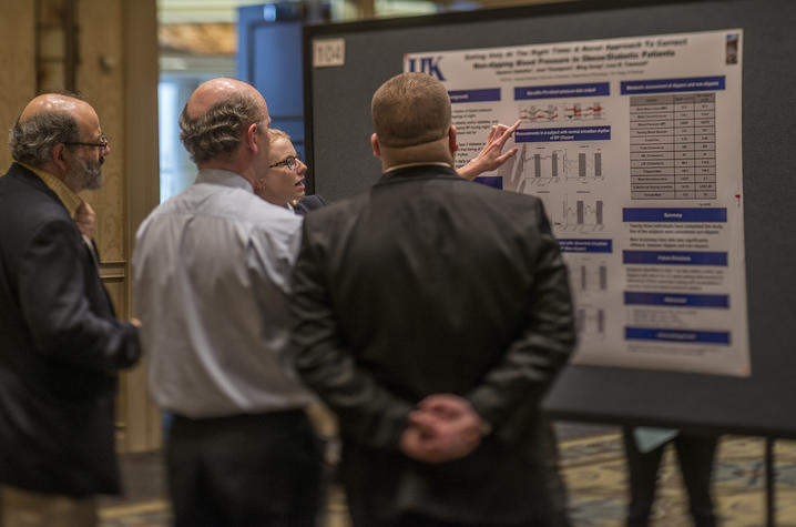 Photo of poster presentation at Cardiovascular Research Day conference