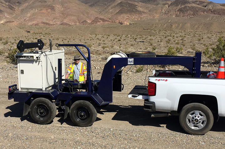 photo of Ed Woolery with active vibratory seismic energy source in Death Valley