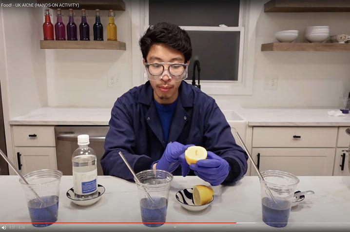 Photo of Faculty Member Doing Experiment