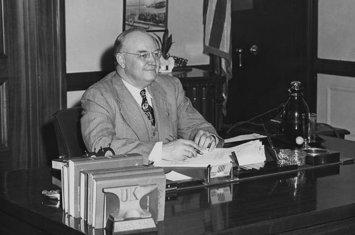 black and white photo of Governor Earle C. Clements seated at desk