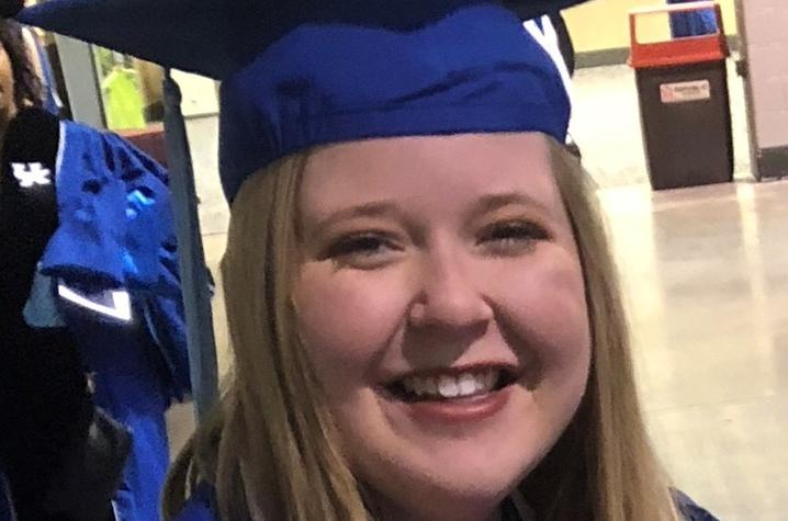 headshot photo of Emily Stoker in cap and gown