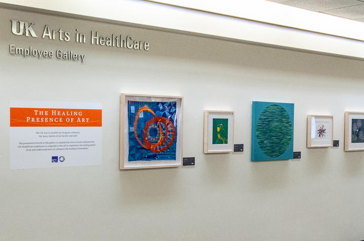 Photo of framed art in employee art gallery