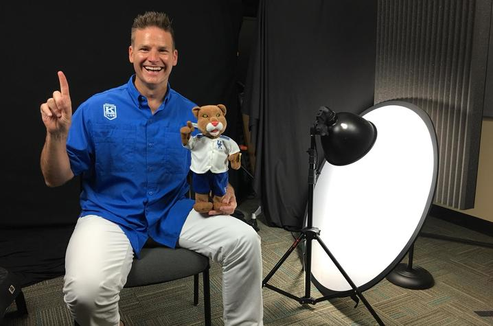photo of Eric Bumm with Wildcat doll