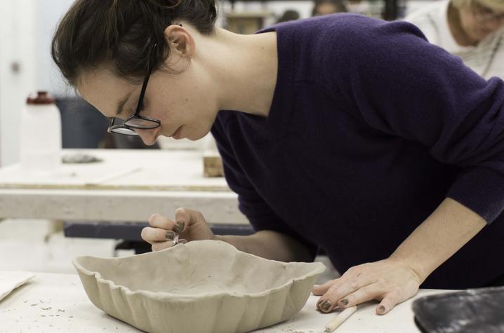 photo of student working in ceramics class - Fine Arts Institute