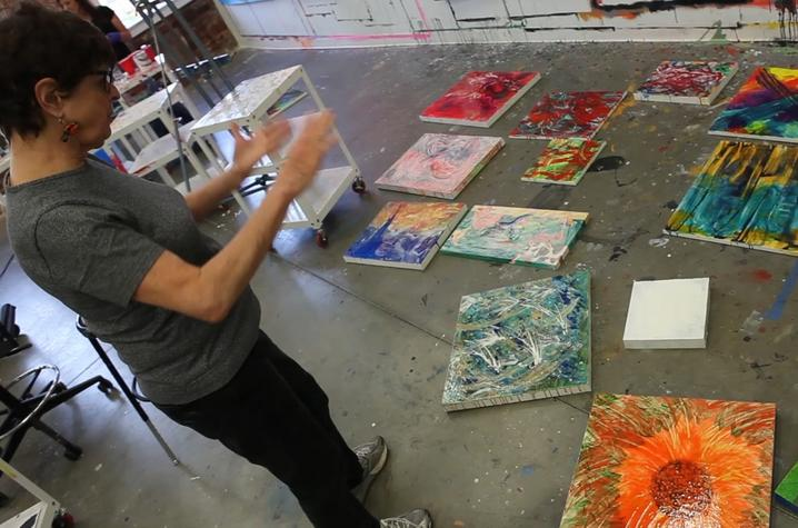 photo of student and contemporary paintings - Fine Arts Institute