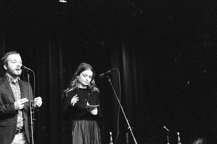 black and white photo of JT Priar and Maddie Marburger presenting at 2018 Fish Tank