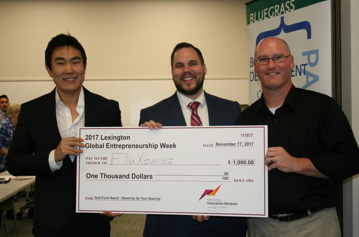 photo of FluXomics check presentation at Standup for Your Startup