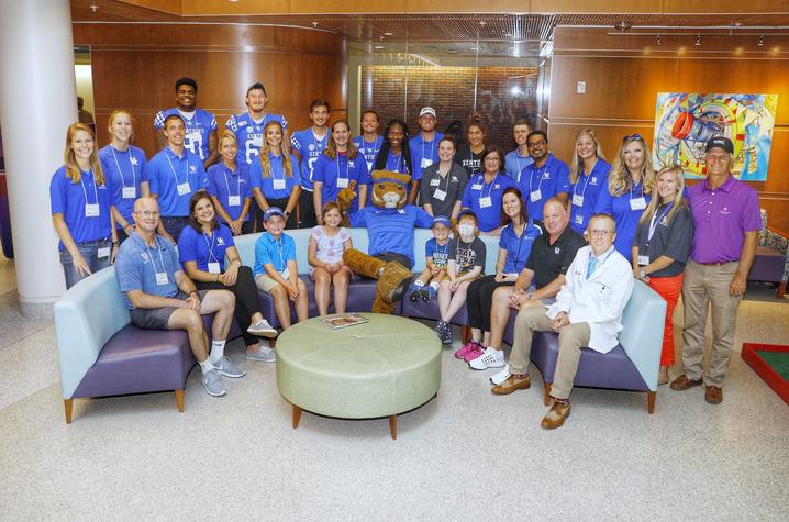 UK student athletes and volunteers cheered on the patients as they putted through a nine-hole course in the children's hospital.