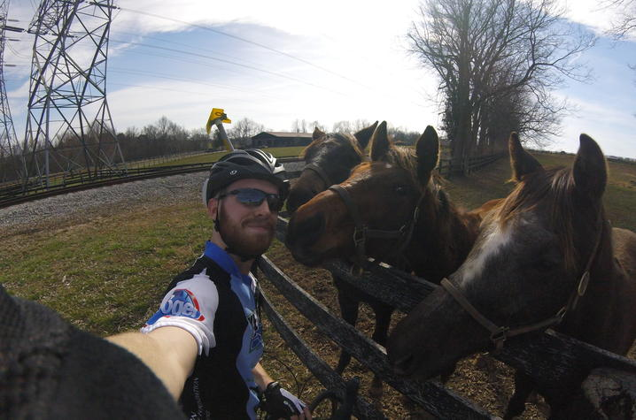 selfie photo of Nate Williams with horses