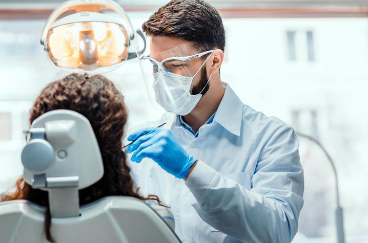 Dentist giving exam