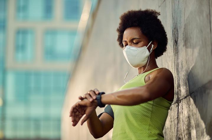 photo of woman wearing smart watch