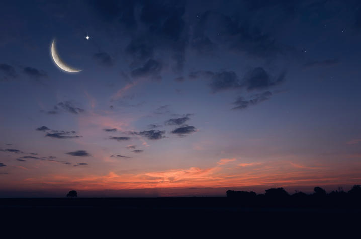 photo of night sky with moon and star