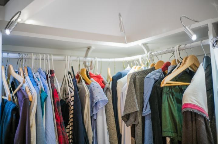 photo of clothing hanging on rack