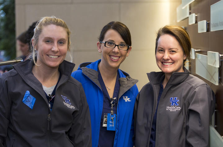 Photo of three employees celebrating Gill's #1 ranking