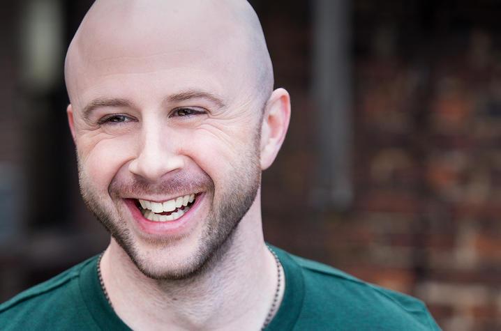 headshot photo of Grady Bowman in dark green short sleeve T-shirt