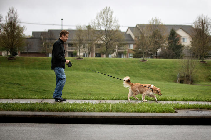 Photo of Gregg Whitaker walking his dog Gracie. Mark Cornelison | UK Photo