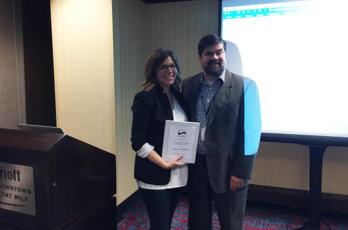 Photo of Adriane Grumbein receiving award