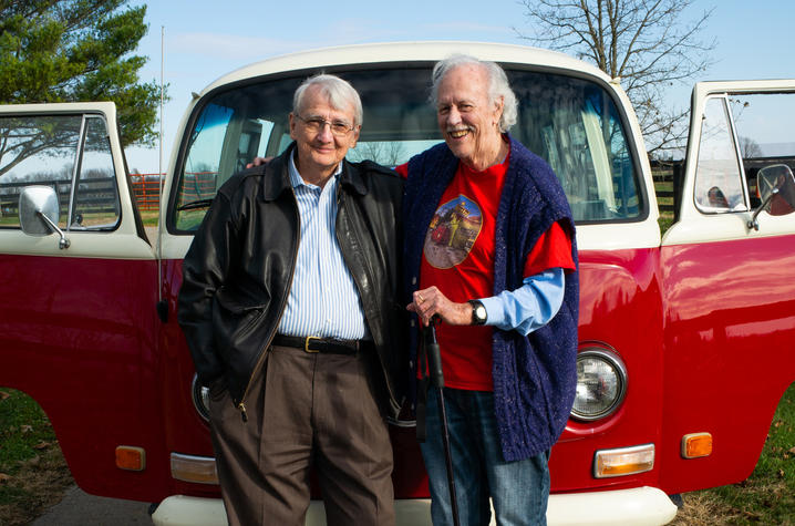 photo of Gurney Norman and Ed McClanahan in front of VW van