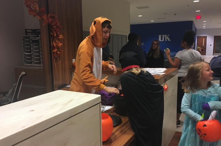 photo of children trick-or-treating in a residence hall