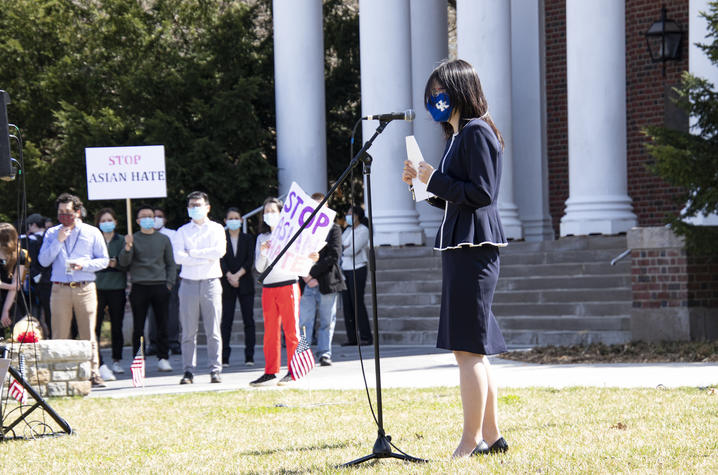 Haoying Sun at microphone in front of Memorial Hall