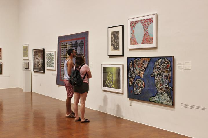 photo of visitors checking out Thomas Nozkowski exhibit at UK Art Museum