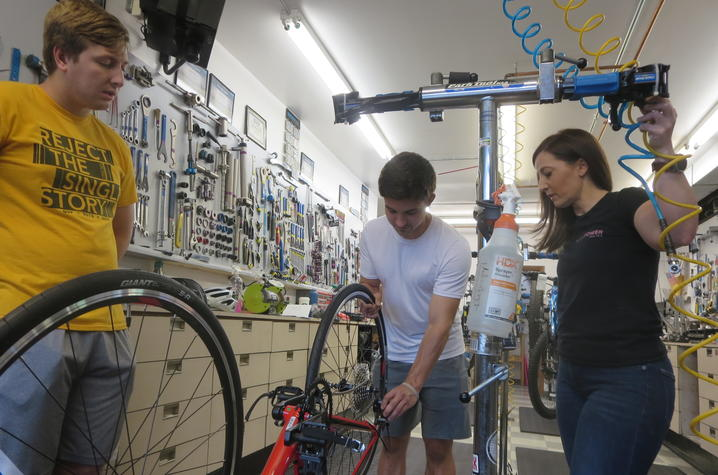 Zach and Robby learn how to maintain their bikes with the team at Pedal Power in Lexington, KY