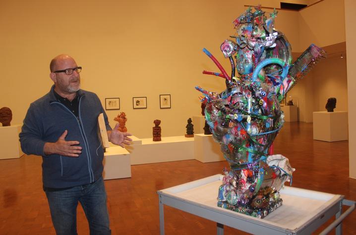 "photo of Stuart Horodner discussing sculpture ""Age of Discovery"" by Robert Morgan"