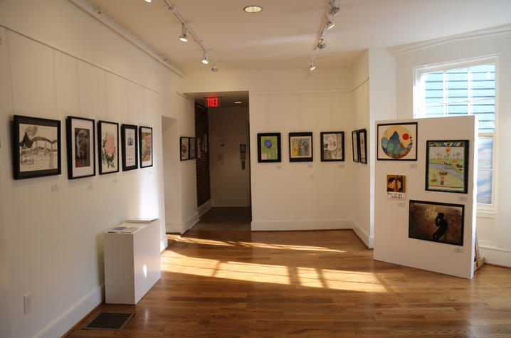 "photo of art on walls for ""In My View"" exhibition"