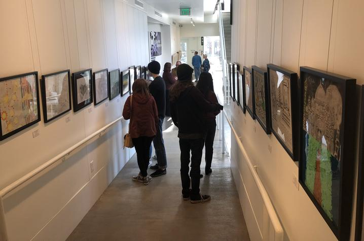 "photo of people looking at art in ""In My View"""