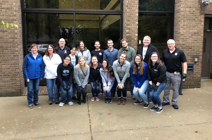 Photo of UK College of Pharmacy students with members of the Lexington Police Department