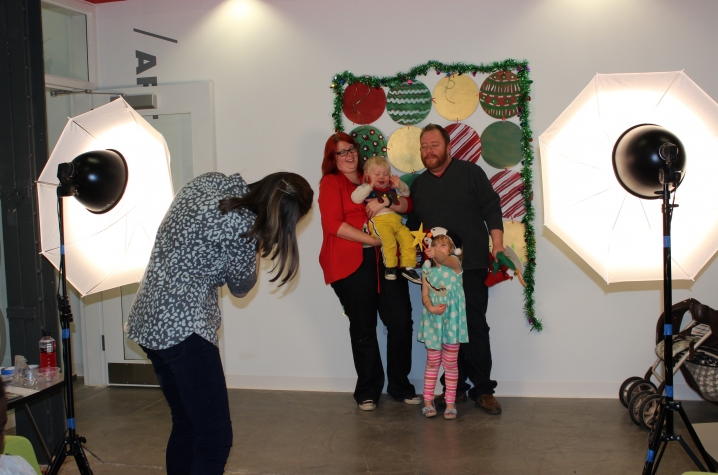 photo of family getting holiday photos - Open Studio 2015