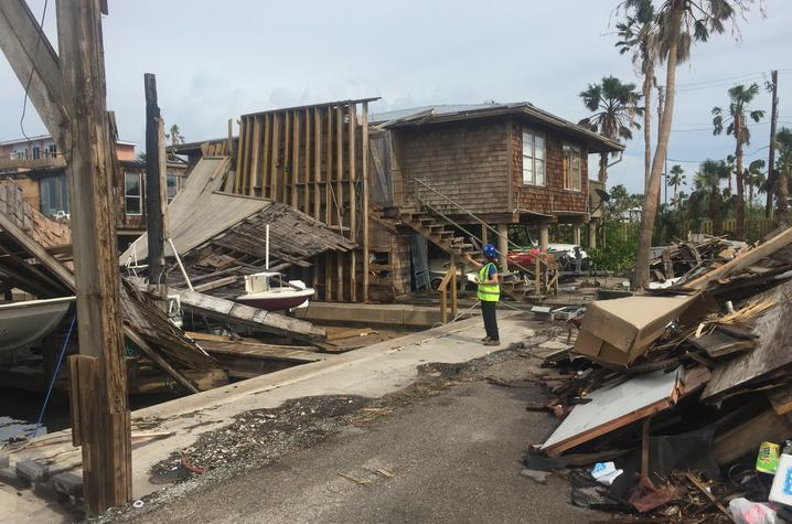 Photo of Mariantonieta Gutierrez Soto surveying damage