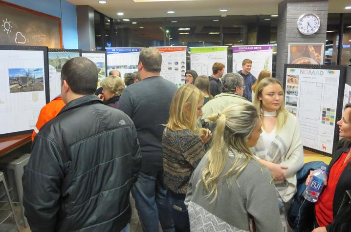 photo of people at Southland Design exhibit at Good Foods Co-op