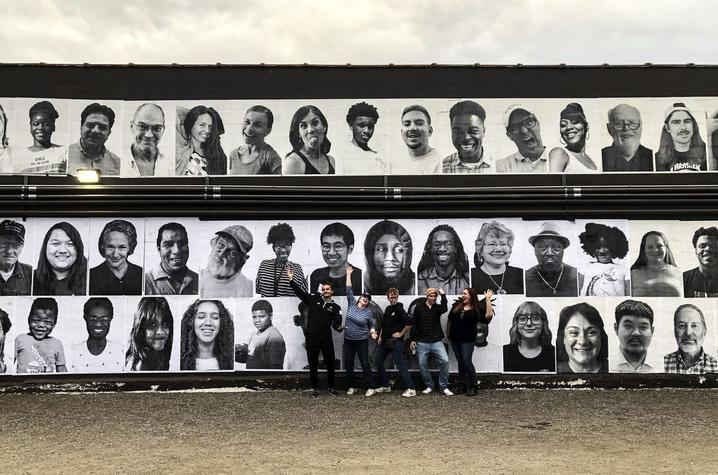 students from guerrilla art class with InsideOutLex installation on Carson's wall