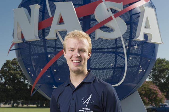 photo of James Tyler Nichols in front of NASA sculpture