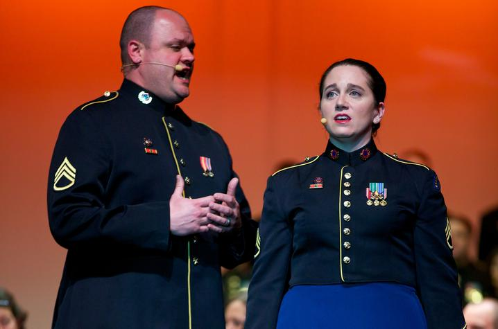 photo of Jeremy Cady and Charis Strange singing a duet in uniform