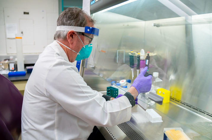 UK researcher Jerry Woodward running a COVID-19 antibody assay in the Flow Cytometry and Immune Monitoring lab. Photo by Ben Corwin, Research Communications.