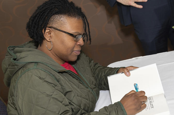 photo of author Keona K. Ervin signing book