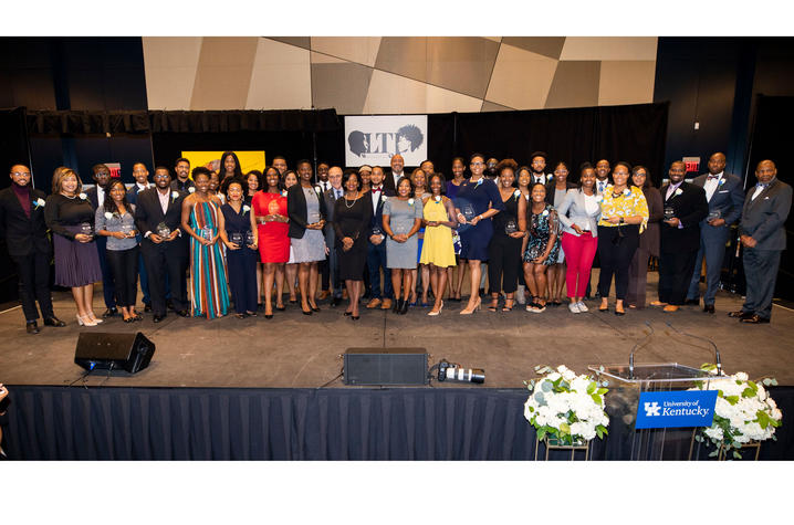 winners of Lyman T. Johnson Torch of Excellence Award on stage