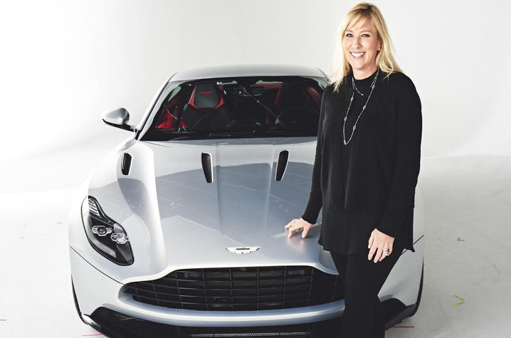 Laura Schwab, president of Aston Martin the Americas, with the DB11. Photo Credit: Aston Martin