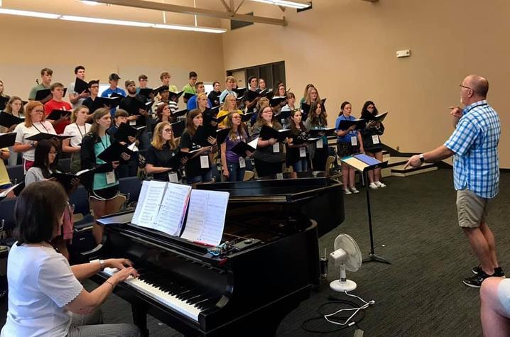 photo of Sue Ellen playing piano and Mickey Ballard directing KBC All-State Youth Choir Rehearsal