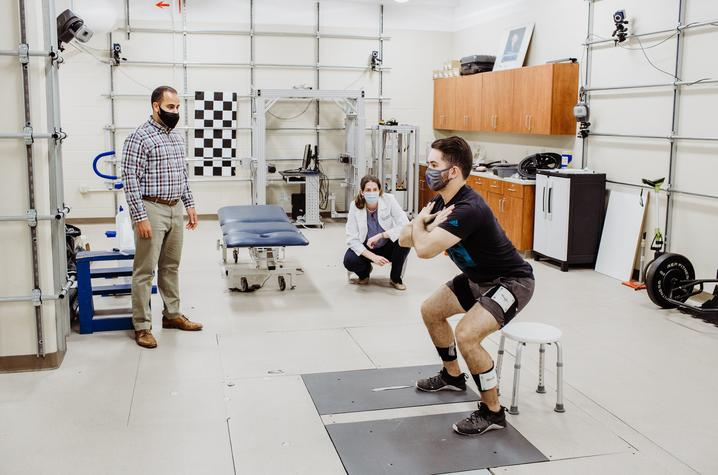 Michael Samaan (left) and Mary Sheppard (center) prepare for the study in the UK Biodynamics Lab with graduate assistant Walter Menke (right).