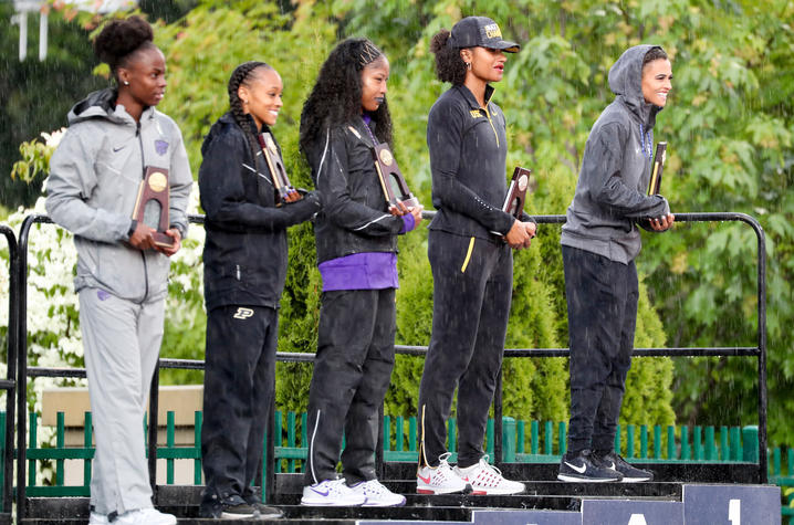 photo of Sydney McLaughlin (far right) with NCAA championship trophy