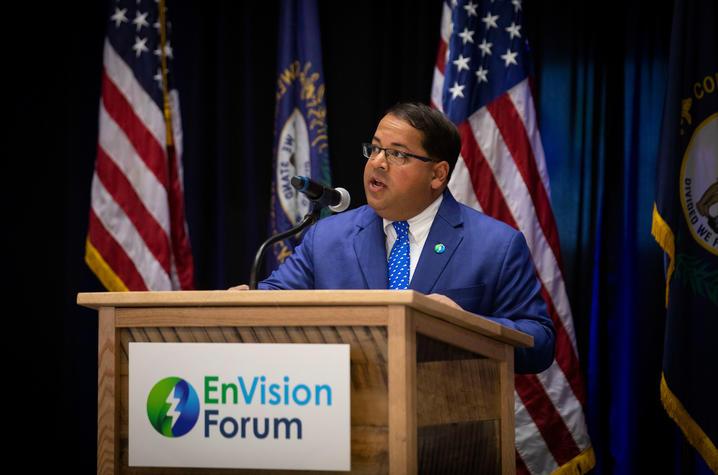 photo of Neal Chatterjee, chairman of FERC, at podium speaking