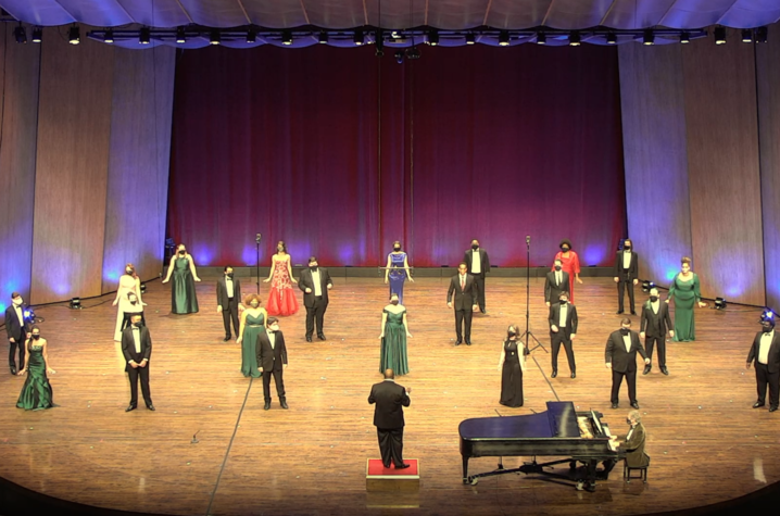 Photo of members of UK Opera Theatre performing six feet apart on the Singletary Center stage for the virtual performance.