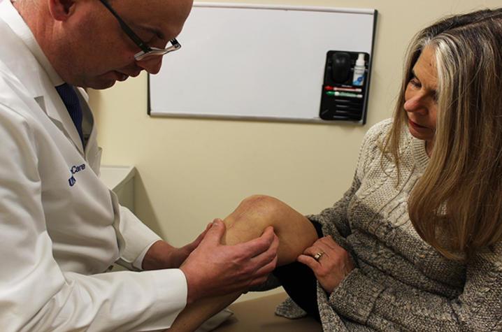 Dr. Christian Lattermann examines Jennifer's knee.