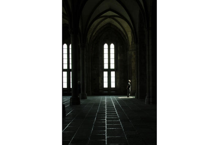 "photo of person looking out window in cavernous hall titled ""Contemplate"" by Lee Ann Paynter"