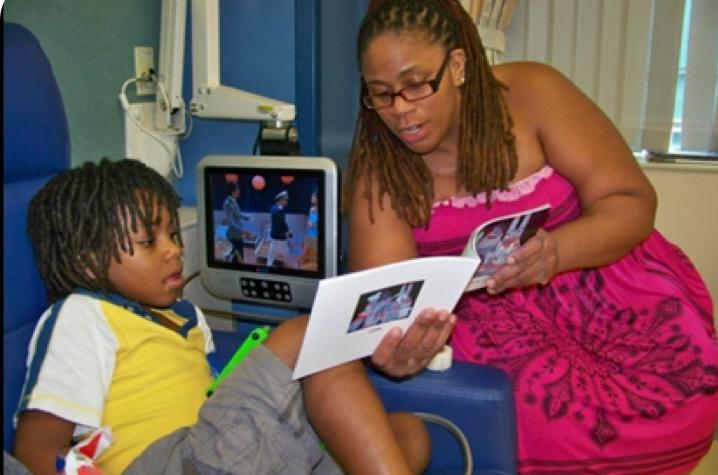 Mother and Child reading from the Cellie coping book